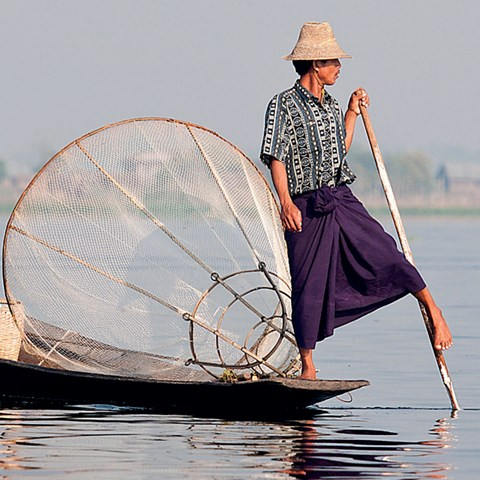 Fisherman in boat in Burma