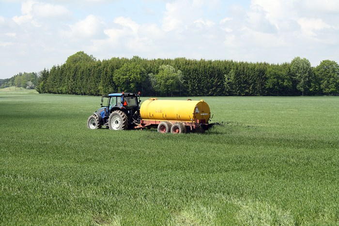 A tractor on a green field, photo.