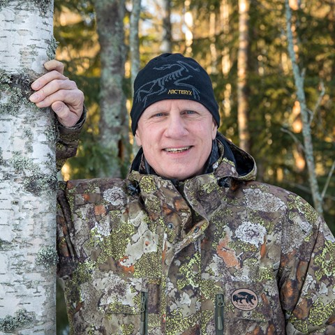 Man next to a birch. Photo.