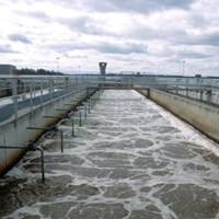 Pool at wastewater treatment plan. Photo.