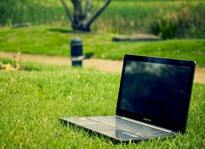 Laptop on a lawn, photo.